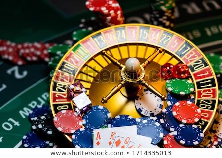 Piros kaszinó kocka kaszinó zsetonok zöld asztal Stock fotó © jirkaejc