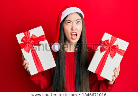 ストックフォト: アジア · 若い女性 · 着用 · サンタクロース · 帽子 · 見える