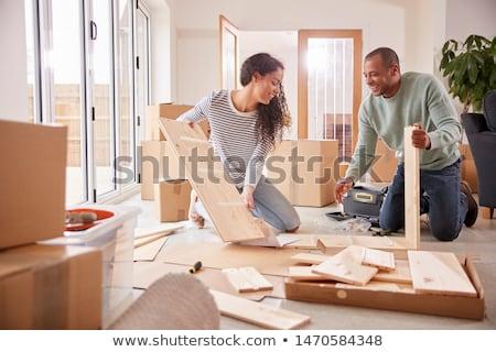 człowiek · opakowanie · meble · budynku · narzędzia · głowie - zdjęcia stock © hasloo