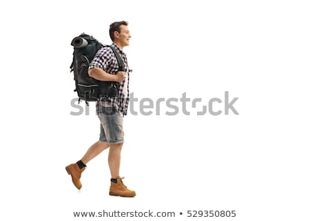Walking young traveller isolated on white Stock photo © Elnur