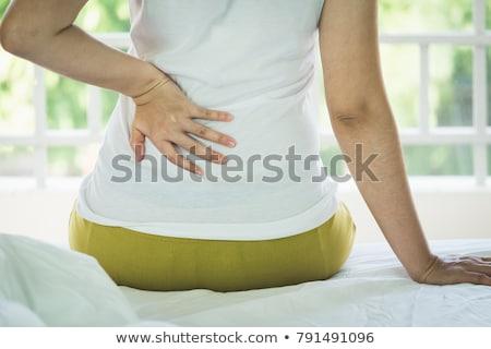 Nő üzenetküldés fájdalom hát izolált fehér Stock fotó © Nobilior