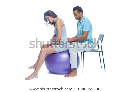 doctor with medical ball and woman patient Stock photo © Flareimage