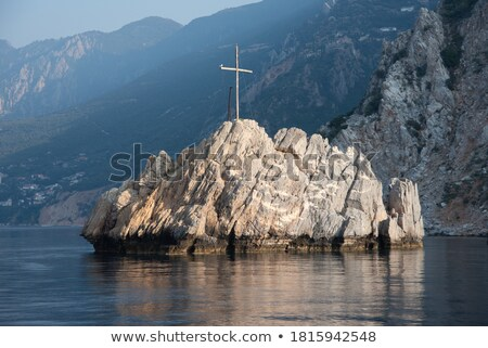 Seascape with a cross on the cliff Stock photo © Kotenko