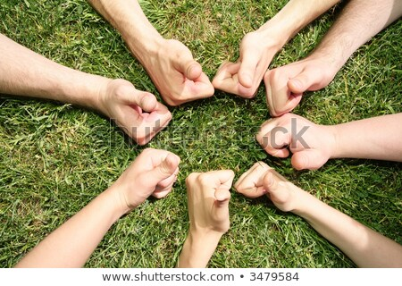 Hands with the fingers lifted upwards on the ground Stock photo © Paha_L