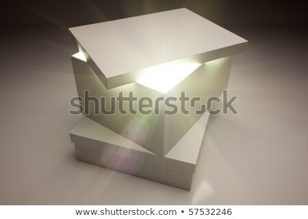 White Box with Lid Revealing Something Very Bright Stock photo © feverpitch