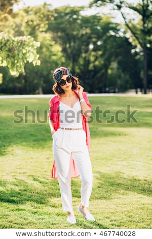 brunette woman walking in the fields with hands in pockets Stock photo © feedough