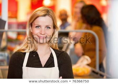Smiling young woman checking out shop merchandise Stock photo © dash