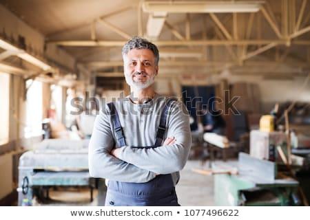 werknemer · portret · permanente · garage · pak - stockfoto © tiero