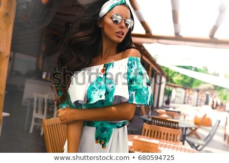 fashion style photo of young brunette wearing glasses stock photo © konradbak