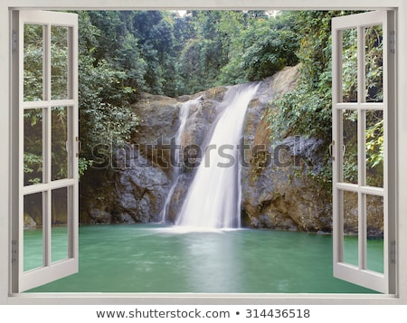 A window with a view of the cliff at the river Stock photo © bluering