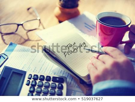 Taxes word on notepad Stock photo © fuzzbones0