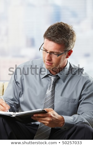 Professional taking notes into organiser Stock photo © nyul