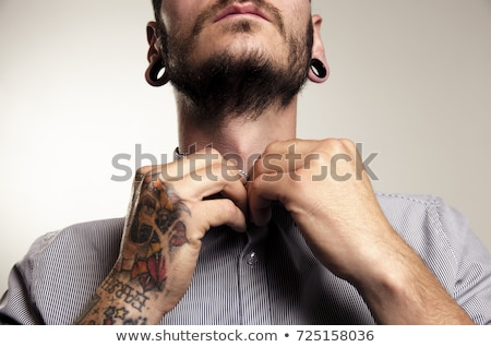 Homem tatuagens caucasiano retrato cor pele Foto stock © iofoto
