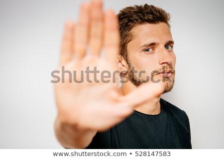 Caucasian businessman showing stop hand gesture. Stock photo © RAStudio