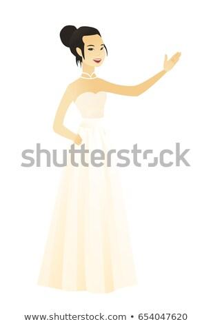 Asian verloofde tonen richting glimlachend Stockfoto © RAStudio