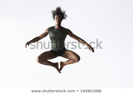 Young ballet dancer in mid air Stock photo © julenochek