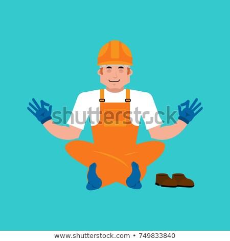 Builder yoga. Worker in protective helmet yogi. Service worker S Stock photo © popaukropa