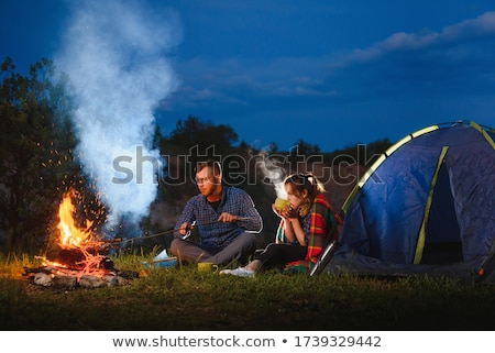 girl resting on tent stock photo © is2