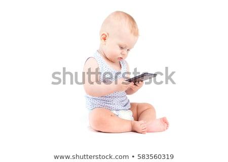 cute joyful baby boy in blue shirt and diaper hold cellphone stock photo © traimak