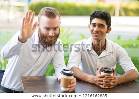 двое · мужчин · Постоянный · улице · связь · улыбаясь · любви - Сток-фото © is2