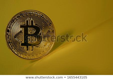 Bitcoins on reflective surface Stock photo © stevanovicigor