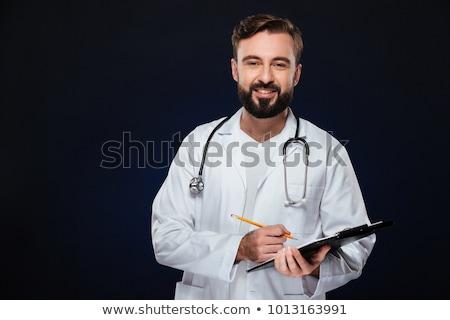 Retrato sonriendo doctor de sexo masculino uniforme jeringa Foto stock © deandrobot