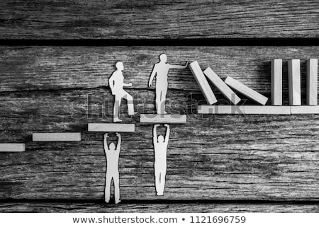 Two White Human Figure Standing On Wooden Desk Stock photo © AndreyPopov
