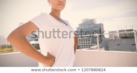 Zdjęcia stock: Side View Of Confident Woman Standing In The City For Breast Cancer Awareness Against Urban Backgrou