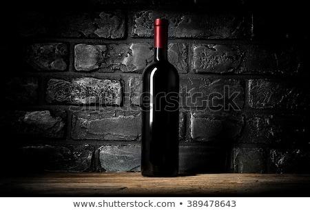 Wine on black bricks Stock photo © Givaga