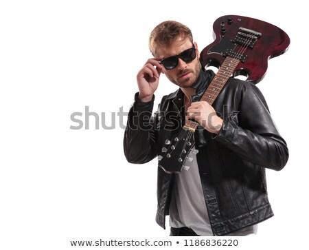divat · férfi · bőrdzseki · napszemüveg · néz · oldal - stock fotó © feedough