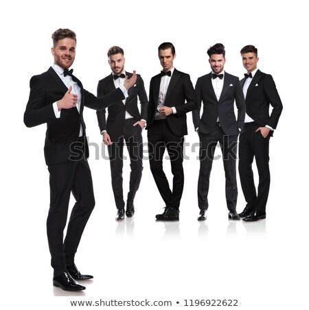 elegant man in tuxedo presenting and making the ok sign Stock photo © feedough