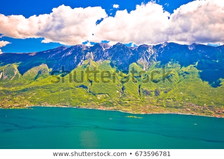 Lago di Garda and high mountain cliffs above Malcesine view Stock photo © xbrchx