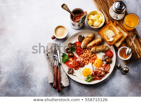 english breakfast fried eggs sausages bacon stock photo © karandaev