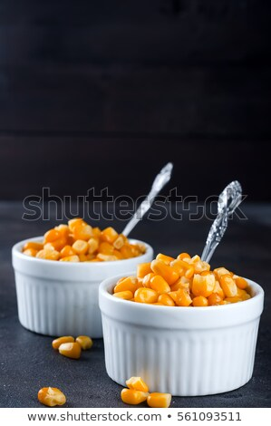 Spoon of canned sweet corn, paths Stock photo © maxsol7