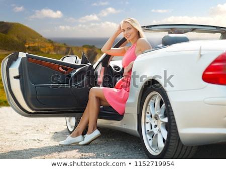 woman posing in convertible car over big sur coast Stock photo © dolgachov