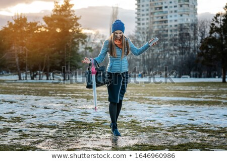 Stock fotó: Woman Having A City Walk In Thawing Snow