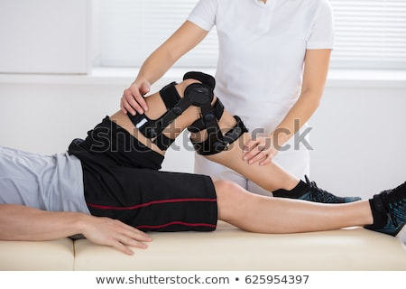 Сток-фото: Man Exercising For Knee Injury Recovery