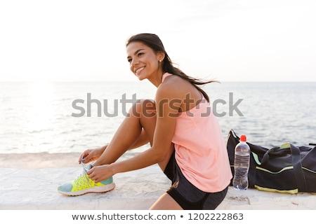 Foto atractivo deportivo mujer 20s chándal Foto stock © deandrobot