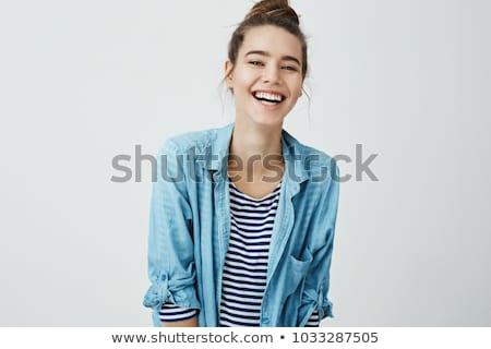 surpreendido · mulher · jovem · sorridente · estúdio · menina · mão - foto stock © studiolucky