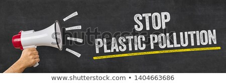 a man holding a megaphone   stop plastic pollution stock photo © zerbor