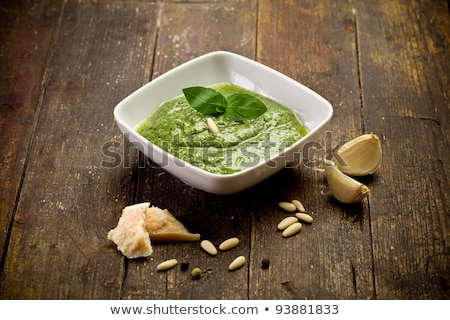 Bowl of pesto on the wooden table Stock photo © Alex9500