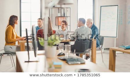 Startup Teamwork Brainstorming Meeting with Graph Planning strat Stock photo © snowing