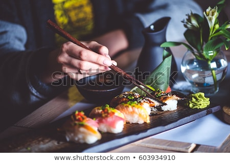 Woman eating japanese food in a japanese food restaurant Stock photo © galitskaya