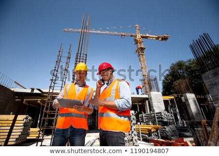 Two Male Architects Working On Construction Site Stock photo © AndreyPopov