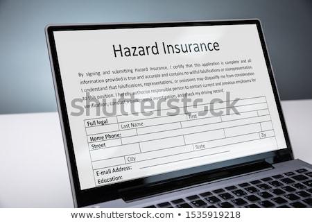 Laptop With Online Hazard Insurance Form Stock photo © AndreyPopov