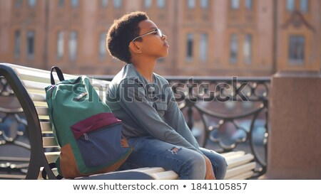 Сток-фото: вид · сбоку · печально · школьник · сидят · только · скамейке