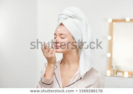 Csinos női élvezi szag új krém Stock fotó © pressmaster
