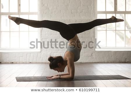 Woman Practicing Standing Split Yoga Exercise Stock photo © rognar