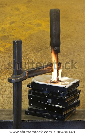 Stockfoto: Stack Of Burning Hard Drives With Clamp
