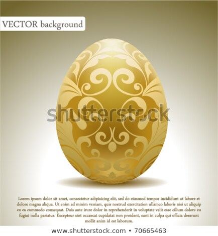 The golden egg with a flower . Isolate on white. Stock photo © g215